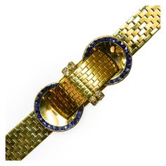 Sophisticated Yellow Gold Bracelet Watch  :  Van Cleef & Arpels.  Small sapphires and diamonds on an 18k gold mounting - Van Cleef movement.  Switzerland and France.       c1940's