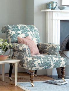 I love the style  fabric of this beautiful blue  white chair. Remember though that an attached seat isn't as comfortable as a loose seat  can't be turned over for equal wear. The rolled back echoing the rolled arms is very attractive.