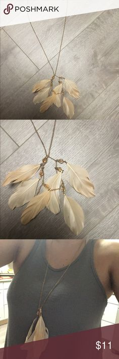 Boho blush pink feather necklace Never worn! Gold chain with feathers. Little pink jewels as well. Super cute with your boho outfit! Jewelry Necklaces