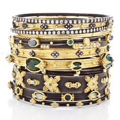 Armenta: Old World midnight and 18K yellow-gold bangles with diamonds, sapphires, and colored-gemstones.