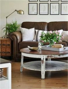 Leather couch, antique bronze lamp, round coffee table