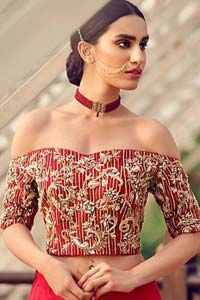 Captured in traditional silhouette, The bridal stands out due to its uniqueness and the perfect fusion of modern cut and traditional embroidery. This dress is beautifully decorated with heavy embroidery. It is highlighted with kora, dabka, tilla, sequins and pearls. Off shoulder blouse is enhanced with zardosi work all over. It comes with full embellished […] The post Pakistani Wedding Wear Red Off Shoulder Blouse Lehenga appeared first on Latest Pakistani Fashion 2020 - Formal Wear - Anar Latest Pakistani Fashion, Zardosi Work, Heavy Dresses, Pakistani Bridal Wear, Wear Red, Red Fabric, Wedding Wear, Dream Dress, Fashion 2020