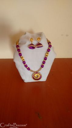 This jewelry set is made of purple and golden silk thread and golden beads in eye-catching color and design. This creation will surely add ethnic look to your attire and a flawless match to wear during festive season. #craftsofindia #indianhandicrafts #madeinindia #craftsbazaar #artsandcrafts #handmade