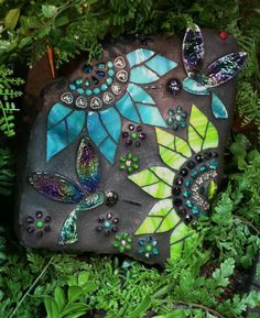 Hummingbird & Flowers. Mosaic on a rock by Carol Deutsch