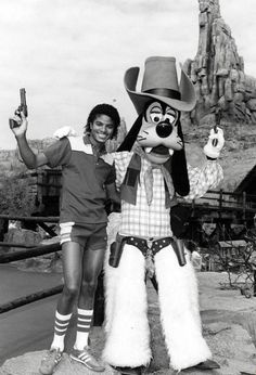 Michael Jackson and Goofy hanging out at Disneyland