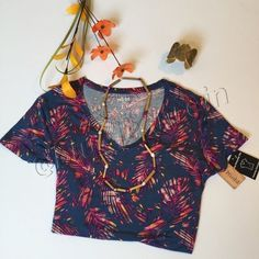 """⬇NWT Mudd Island Floral Graphic Tee! NWT Mudd Navy Palms Print Graphic Tee! This shirt is SO soft, it's made of a spandex and rayon blend. The print is really pretty, my sister has this shirt and gets compliments on it all the time! Juniors size XL, equivalent to adult L. Mudd size chart lists Juniors XL as size 13-15 for women and this shirt has a bust of approx. 38.5"""" flat and will stretch to about 40"""" due to the spandex in the shirt. Tagless design, v-neck. A truly understated and…"""