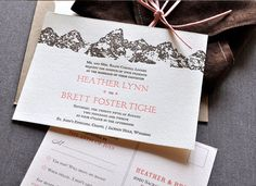 Letter-pressed invitations with the Teton Range in the background wrapped in brown suede with pink suede ties for a Jackson Hole wedding