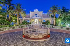 While grand staircases are pretty common inside homes, this Florida mansion comes with an impressive one outside. Once you make the trek to the 21,865-square-foot main residence, you'll find water views (of the two backyard pools, the Atlantic Ocean, and the Intracoastal Waterway) from most of the 18 bedrooms, 26 bathrooms and countless other living spaces.