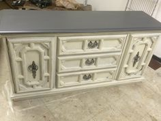 """Are you looking for one of those versatile pieces that can be used as a buffet or tv stand? Then here you go!  (It wouldn't be a great dresser since the two corner doors open to a wide open space).  The dimensions are 64"""" L, 20"""" W, 35"""" H. Sold for $275"""