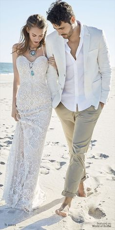 Ivory / Cashmere lace bridal sheath. Sweetheart neckline with spaghetti straps and a low open back.