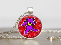 Hey, I found this really awesome Etsy listing at https://www.etsy.com/listing/211892986/the-grateful-dead-bear-jewelry-pendant