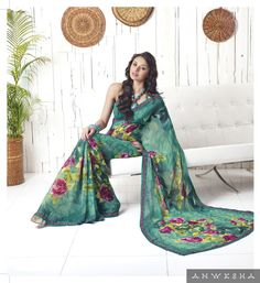 Its a Printed green saree of georgette, It has a border of lace strip which makes this sari an exclusive wear for a short party or your household use. Liked by each husband. We offer this saree with an unstitched blouse which has a lace border.