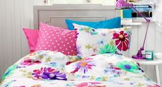 bold, bright and fresh color work well in a teen girl's room ~ mix and match prints