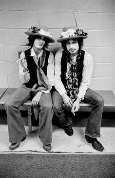 Joan Baez and Bob Dylan backstage on the Rolling Thunder Revue tour in 1975. Photo by Ken Regan.