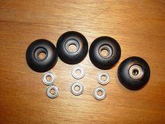 Skate board wheels for sliding barn door. Looks so simple.