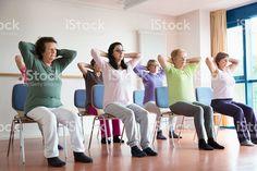 active senior women yoga class on chairs royalty-free stock photo