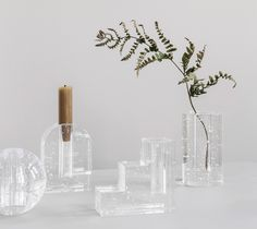 Cast glass vases and candlesticks by Ferm Living