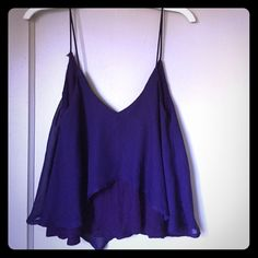 Purple tank Dark purple tank with cotton bottom layer and chiffon top layer. Super cute with jeans and shorts! Gently used. Sparkle & Fade Tops Tank Tops