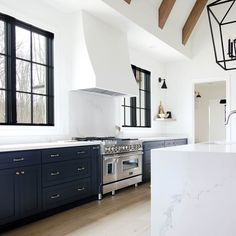 While designing the finishes of our new kitchen, we knew that we wanted to keep the overall look very clean and a mix of modern and traditional. We wanted the hood to have a seamless look, flowing from the wall and ceiling. Range Hood Cover, Range Hood Insert, Wall Mount Range Hood, Kirchen Design, Diy Kitchen, Kitchen Decor, Kitchen Ideas, Kitchen Upgrades, Long Kitchen