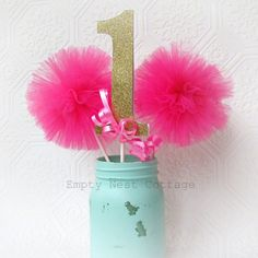 Thank You for visiting Empty Nest Cottage....  This listing is for 2 Pink Tulle Pom Poms and a double sided gold glitter number one with pink