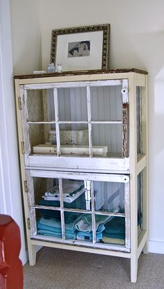 DIY cabinet from old windows Cabinet constructed of two salvaged windows (the doors), electric knobs as handles (from knob & tube wiring), salvaged wood for the frame, old barn wood for the top, beadboard left over from a wall project as the back, and chicken wire sides #recycle #salvage
