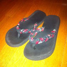 black flip flops w/ red, black, white braided bandana straps
