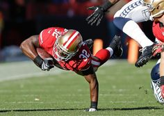 San Francisco 49ers running back Kendall Hunter dives for extra yardage as he carries the ball. (Marcio Jose Sanchez/AP)