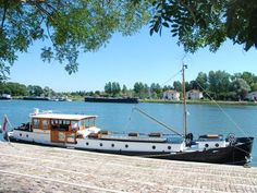 The Randle, 72 foot classic motor barge, at mooring on river Soane, Burgundy, France.
