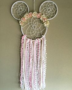 Boho Minnie Mouse Floral Dreamcatcher Unique handmade item Pink and white Minnie Mouse Inspired Dreamcatcher. Large size Dreamcatcher. Made with trims, yarns, florals, and wood. Perfect for: Birthdays, parties, nurseries, home decor, or gifts Sold by luneradreams on etsy. Made in NJ