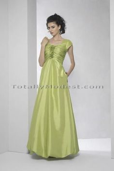 Charity — Square neckline with short petal sleeves and rouched bodice with center flowers. Empire waist. long skirt with bubble hem and zipper back. Silky taffeta. Shown in chartreuse — lots of color choices.  — I wonder whether the young women know about this site for prom and homecoming? Lots of beautiful styles, with different lengths and fabrics —even some cute prints!
