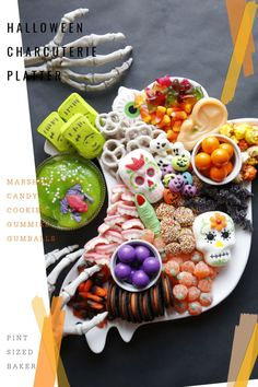 Enjoy a spook-tacular spread with a Halloween Charcuterie Board! Load up your favorite orange, green, purple, and black candies and cookies for a fun DIY dessert tray that everyone will love! #halloweentreat #halloweencandy #charcuterie #easydessert #fingerfood