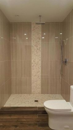 Our White sliced pebble tile is an incredibly popular style with a unique white hue. Made from natural Indonesian river rocks from the island of Sumatra, the pebbles or ancient river rocks are sorted… Modern Shower, Modern Bathroom, Small Bathroom, Master Bathroom, Bathroom Ideas, Bathroom Designs, Shower Designs, Shower Ideas, Big Bathrooms