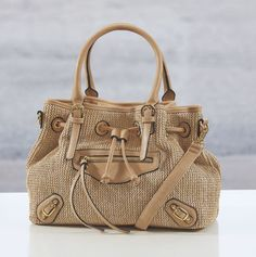 A textured handbag is just the accessory you need this Fall!