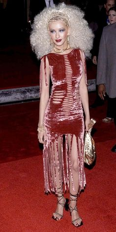 Christina Aguilera wears a shredded red velvet dress and blond afro to the 2001 Blockbuster Entertainment Awards