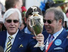 Bob Baffert holding the Preakness trophy & Ahmed Zayat