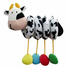 "Edu-Petit Dangly Activity Toy, Cow by Edu-Petit. $15.30. From the Manufacturer                Our spiral Dangling Cow will provide hours of fun and stimulation for your baby. Colors, textures and sound provide a total sensory experience. Easily attaches to stroller, car seat, or crib. Each dangle leg features one of the following: crinkle paper noise, rattle, baby safe mirror, and baby laughing. It's face measures 4 1/2"" x 4"" and is made of super soft velour cloth. The body i..."