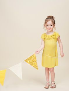 Hucklebones summer 2013, yellow is one of the summers top trend colours in kids designer fashion and here is a simple shrug on knitted dress with a styled neckline