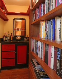 Prohibition style bar behind a bookcase