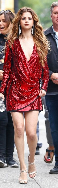 Who made Selena Gomez's red sequin dress and gold sandals? Dress - Balmain, Shoes - Jimmy Choo