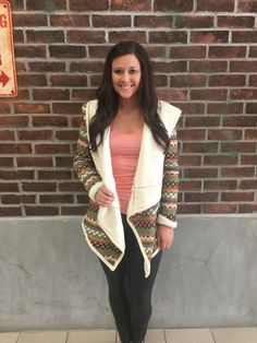 Fall Colors. All-over tribal  Aztec print hooded toggle jacket with teddy bear lining and raw edge detail. This jacket is perfect for layering and to provide warmth. The tribal aztec print brightens this cozy knit cardigan with long sleeves and an open front.