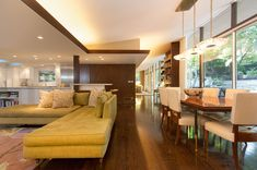 Gorgeous L Shaped Sofa beside Dining Room Which is Decorated by Mid Century Modern on Hardwood Flooring