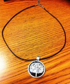 'Monochrome Tree Necklace' handmade pendant on a leather extender chain.  At $15 I add a matching European charm bracelet seen in picture 3