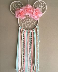 Minnie Mouse Dreamcatcher Large size Dreamcatcher Made with florals, ribbons, trim, yarns, and wood Perfect for: birthdays, parties, home decor, children's bedroom, photo shoots, or gifts. Handmade in NJ