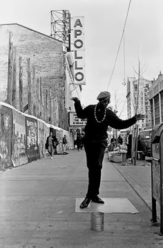 125th Street Harlem, NY. May, 1993 — 'This fellow calls himself Dancing Harry' – by Ozier Muhammad