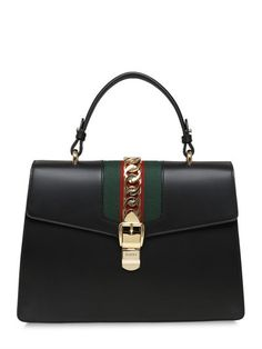Medium Sylvie Leather Top Handle Bag Gucci  Source: http://www.closetonthego.com/e-shop-product/210687/medium-sylvie-leather-top-handle-bag/ © Closet On The Go