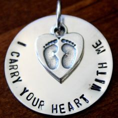 "I carry your heart with me baby feet memorial necklace inspired by E.E. Cummings- meaningful sympathy and remembrance gift for a miscarriage or infant loss.  Sterling silver, hand stamped necklace. ""I carry your heart with me"" charm measures 1″ – option to personalize with custom phrase. Heart charm engraved with baby feet charm. Optional Swarovski crystal to represent birthstone or month of loss."