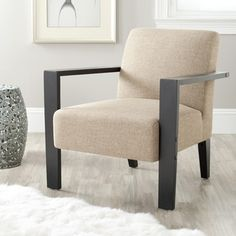 @Overstock - This unique yet comfortable beige arm chair by Solo will bring attention to any office or home. Quality linen covers a large cushioned seat and back while wide, pine-wood arms provide support. Solid construction with an artful appeal for any decor.http://www.overstock.com/Home-Garden/Solo-Beige-Linen-Arm-Chair/6971975/product.html?CID=214117 $251.45