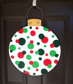 Items similar to Christmas ornament door hanger. on Etsy Halloween Wood Crafts, Christmas Wood Crafts, Christmas Rock, Homemade Christmas Gifts, Christmas Projects, Holiday Crafts, Christmas Wreaths, Christmas Decorations, Christmas Ornaments