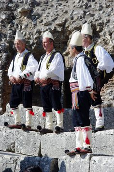 At a celebration. Albanian men in traditional clothing. (V)