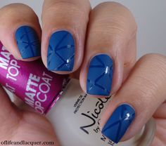 Kiko 383 Oil Blue with striping tape and matte topcoat. Easy nail art.